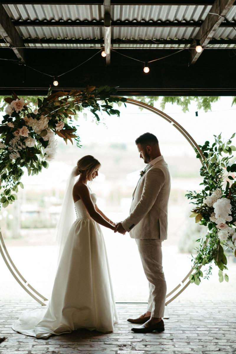 Brennah and Trent's winery wedding, real bride wearing the Bespoke Blake Camille wedding dress by Karen Willis Holmes.