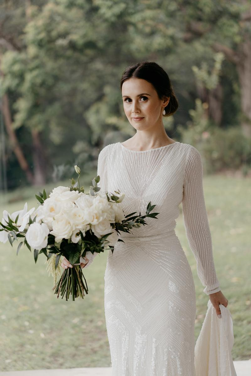 KWH bride Anna holding timeless bouquet wearing the art deco inspired Cassie wedding dress