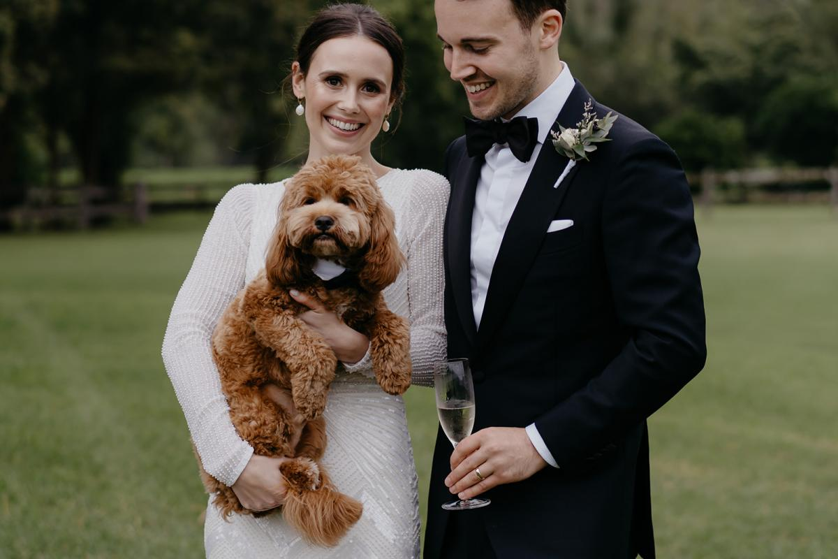 Karen Willis Holmes bride Anna and her husband Julian with their adorable dog. Anna wearing the Cassie wedding dress.
