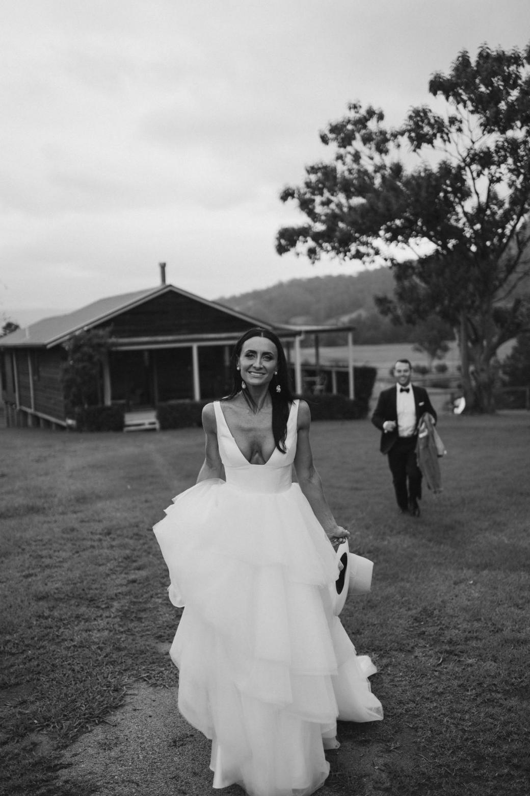 Real bride Sarah wears the Taryn Marina gown, a Bespoke wedding dress by Karen Willis Holmes.