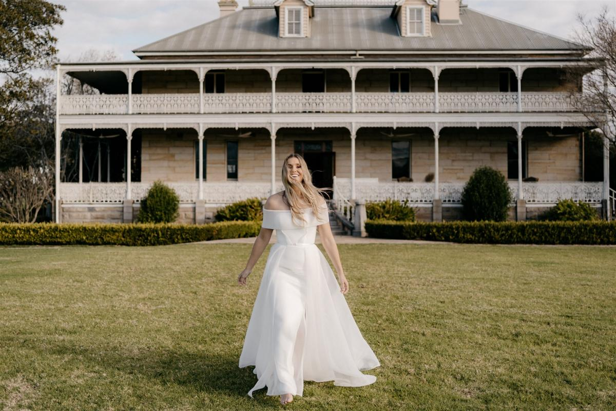 Model wears Esther A-line wedding dress style silhouette in sculptural mesh by Karen Willis Holmes