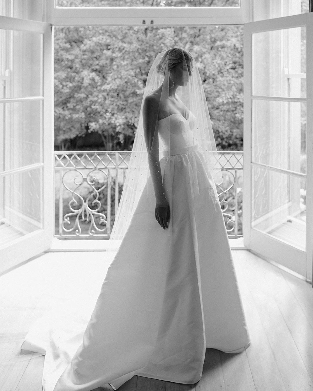 Model wears Blake Camille ball gown wedding dress style silhouette in twill by Karen Willis Holmes