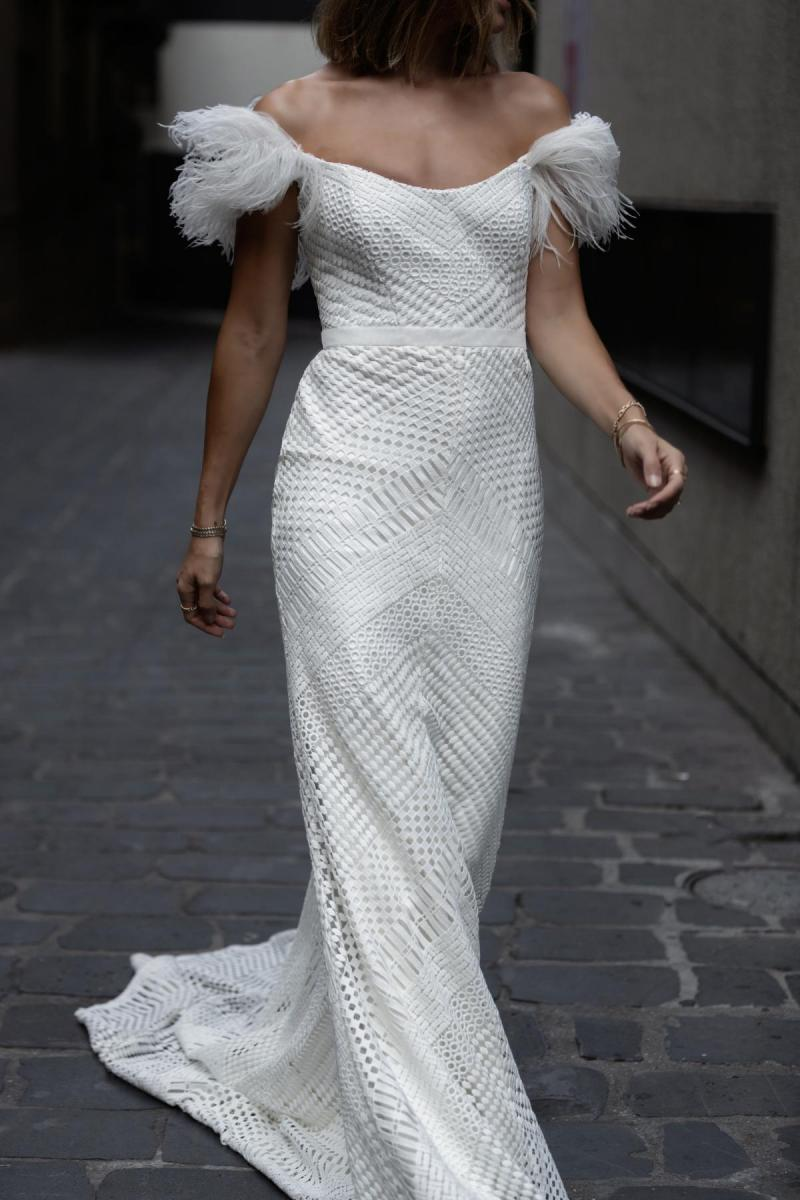 Model wears Annabelle Off-shoulder wedding dress style silhouette in Giupure lace by Karen Willis Holmes