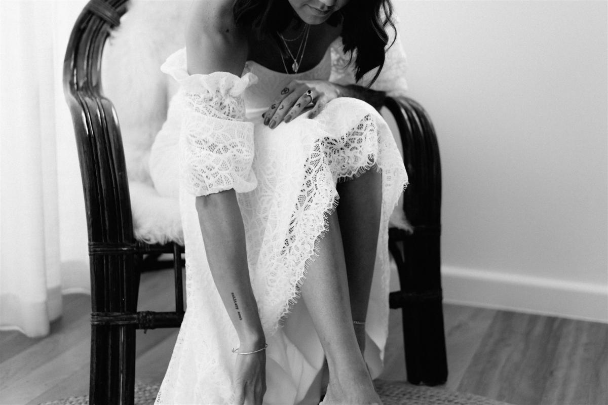 Real bride wears Vivienne Off shoulder wedding dress style silhouette in lace by Karen Willis Holmes
