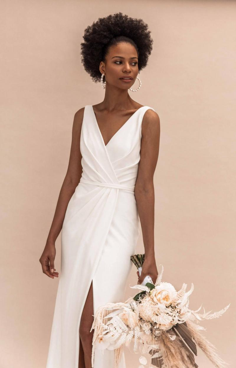 Model wears Nikki V-neck wedding dress style silhouette in stretch crepe by Karen Willis Holmes