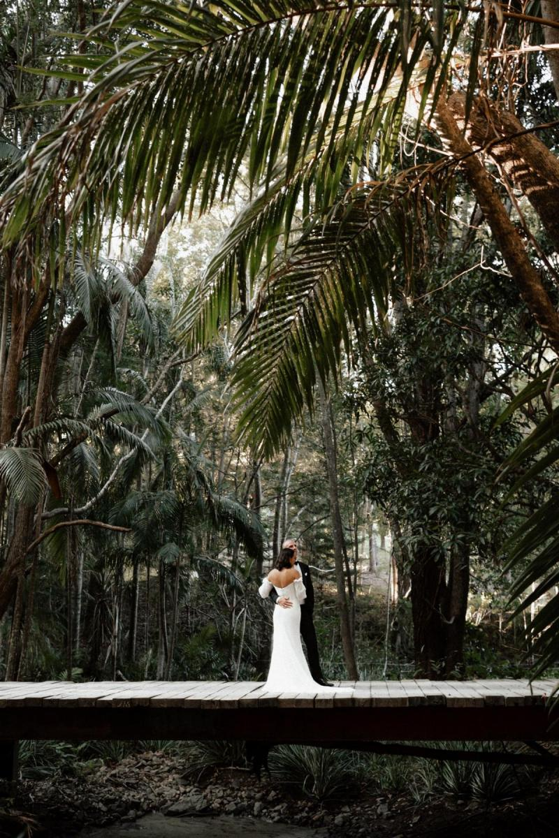 KWH bride Lidia with husband Dayne in forest of Tweed Coast, bride wears the lace Vivienne gown by Karen Willis Holmes.