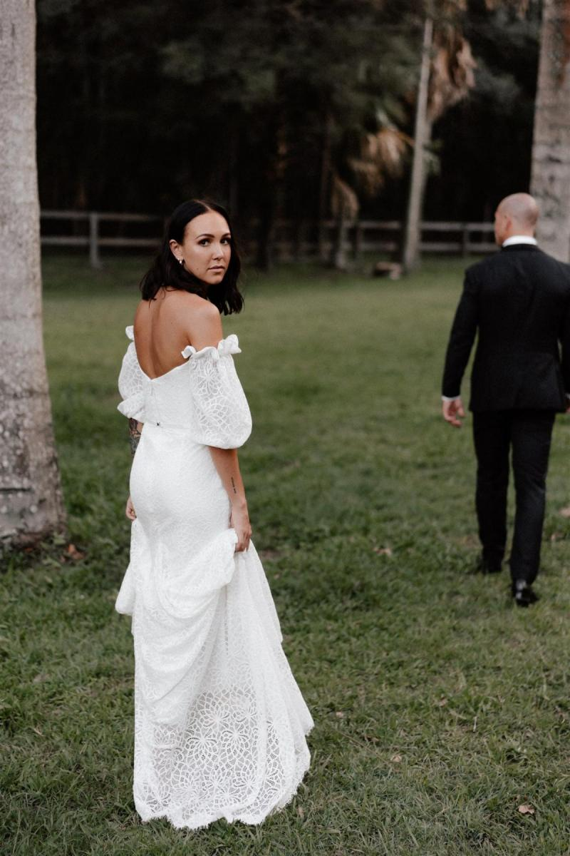 Real bride Lidia wears the Vivienne wedding dress to her open church wedding, a floral lace wedding dress by Karen Willis Holmes for the boho bride