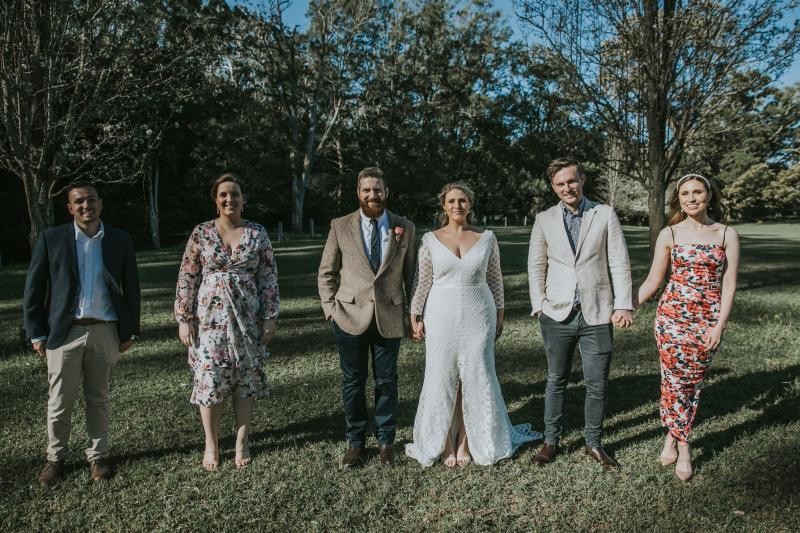 Curvy bride Lucy with bridal party, wearing the Bobby lace wedding dress by Karen Willis Holmes.