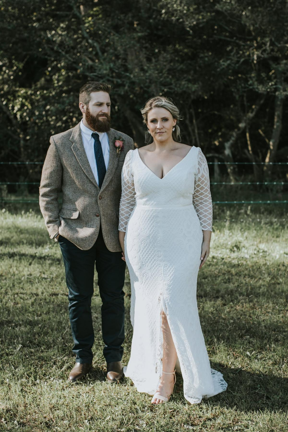 Curvy real bride Lucy wears the Bobby gown to wedding reception; a modern lace wedding dress with custom sleeves by Karen Willis Holmes.