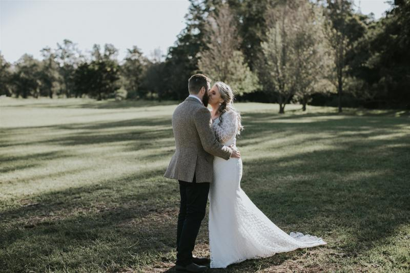 Curvy real bride Lucy wears the Bobby gown; a modern lace wedding dress with custom sleeves by Karen Willis Holmes.