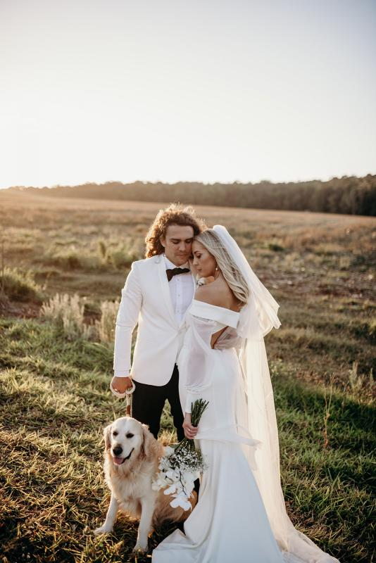 Real bride Hannah wears the Lauren gown with cut open back and off shoulder long sleeves by Karen Willis Holmes