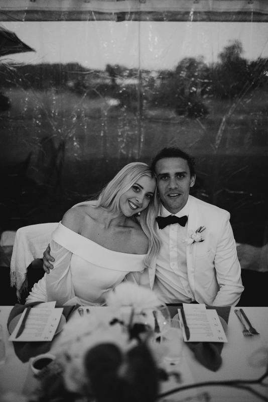 Real bride Hannah wears the Lauren gown; an off shoulder wedding dress with customised Nikki sleeves by Karen Willis Holmes