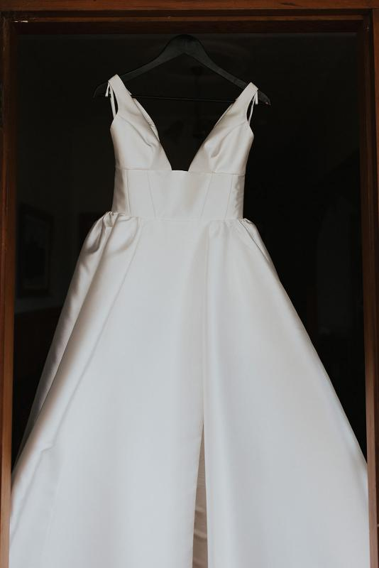 Details of the classic Taryn Camille gown; a modern a-line wedding dress with a U-neck and full skirt by Karen Willis Holmes