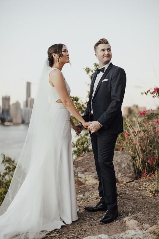 Real bride Melissa wears the Bridget gown to beach wedding, a relaxed casual halter wedding dress by Karen Willis holmes, paired with the KWH Claude Veil; a minimalists bridal veil.