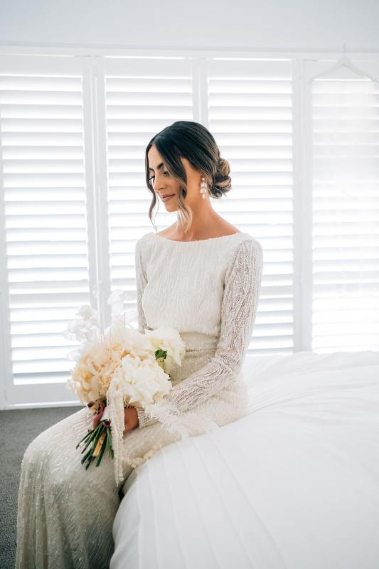 Real bride Katrina getting ready for wedding, wearing the Margareta gown, a long sleeve backless wedding dress Karen Willis Holmes.