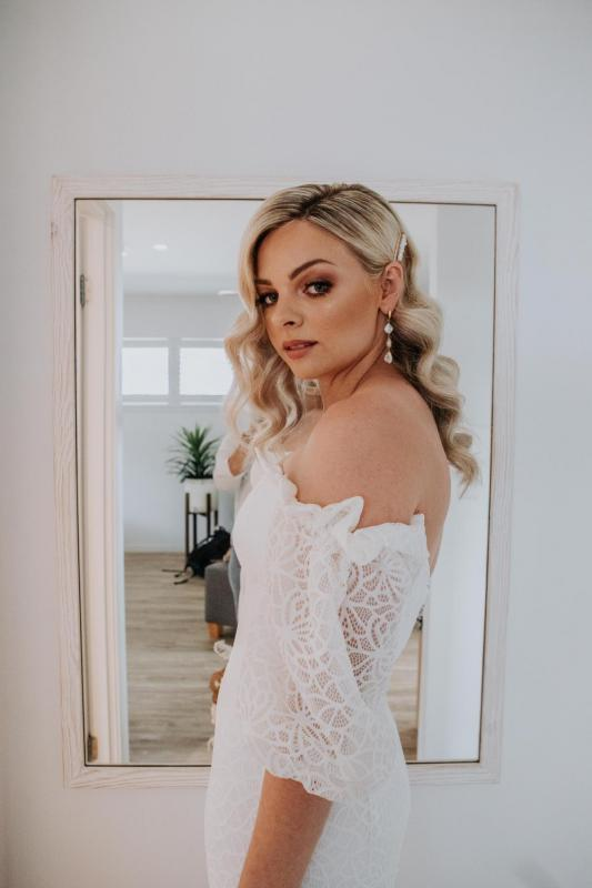 Real bride Kacie-Lee getting ready for wedding, wearing the Vivienne gown by Karen Willis Holmes; a puff sleeve boho wedding dress.