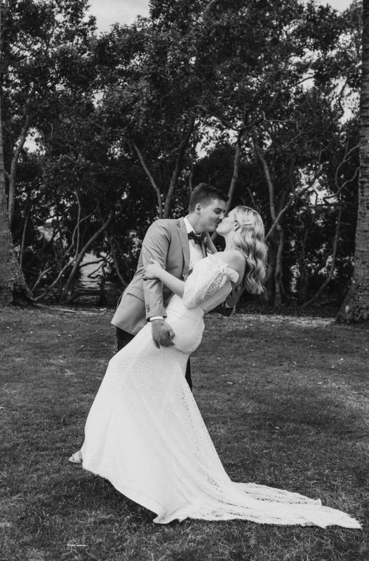 Real bride Kacie-Lee wears the Vivienne gown; a puff sleeve lace wedding dress by Karen Willis Holmes, from the Wild Hearts Collection.