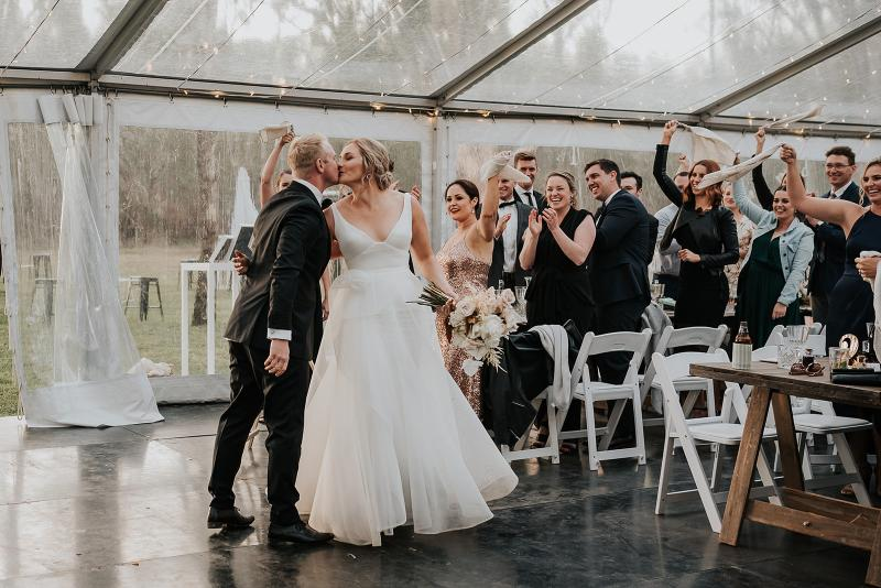 Real bride Samantha wears the Aisha gown to her intimate wedding reception; a V-neck A-line wedding dress by Karen Willis Holmes