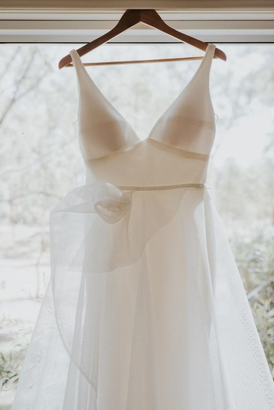 Details of the Aisha gown's floral detailing; a v-neck a-line wedding dress by Karen Willis Holmes.