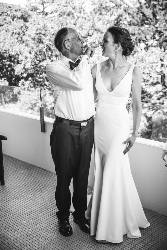 Real bride Joan with her father on the day of her wedding, wearing the Imogen gown; a chic simple v-neck wedding dress by Karen Willis holmes.