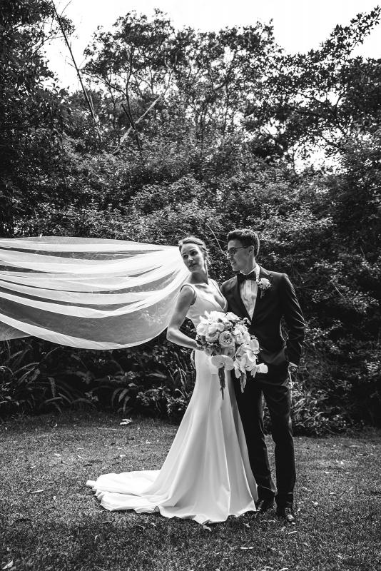 Real bride Joan wears the Imogen gown oner her Sydney wedding day, a chic simple v-neck wedding dress designed by Karen Willis Holmes with dramatic veil.