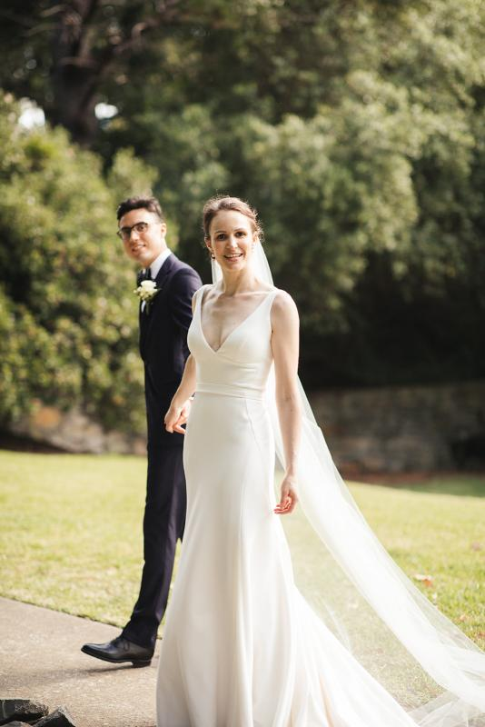 Real bride Joan wears the Imogen gown oner her Sydney wedding day, a chic simple v-neck wedding dress designed by Karen Willis Holmes.