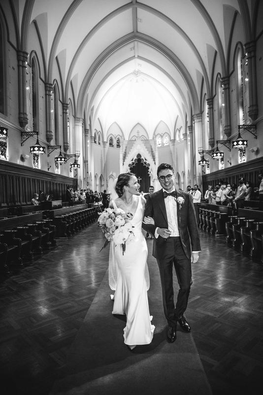 Real bride Joan wears the Imogen gown oner her Sydney wedding day, a chic simple v-neck wedding dress designed by Karen Willis Holmes in church wedding.