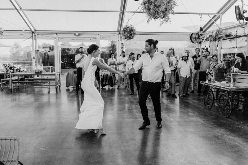 New bride, Kate dances the day away with her husband, Mik, on the dance floor. She wears the modern Arabella gown by KWH.