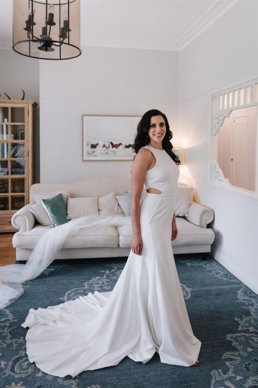 Real Bride Marianne getting ready for her Sydney wedding wearing the Bridget gown & Lea Skirt; a simple halter neckline wedding dress with pearl skirt overlay by Karen Willis Holmes.