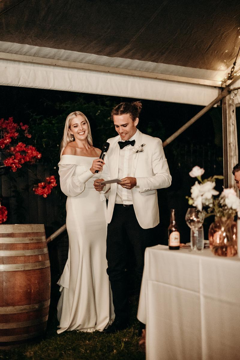 Real bride Hannah wears the Lauren gown at wedding reception