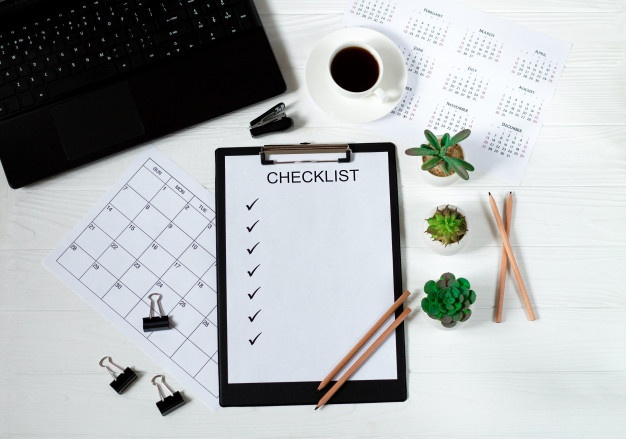 office business desk with checklist