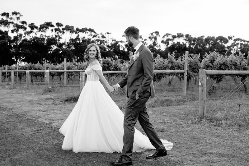 Real bride Jess wearing the Audrey gown; a polka dot wedding dress by Karen Willis Holmes.