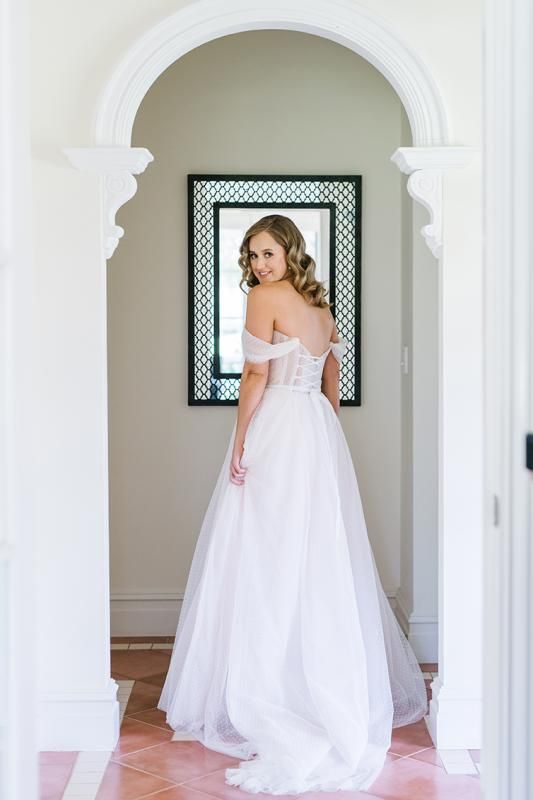 Real bride Jess getting ready for her wedding, wearing the Audrey gown; a polka dot wedding dress by Karen Willis Holmes.
