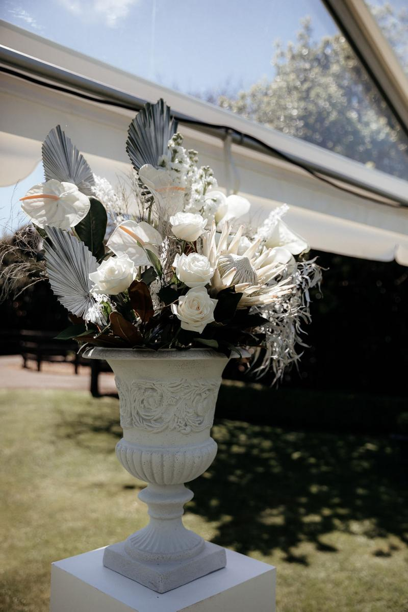 KWH real bride Hannah's ceremony floral arrangment by The Flower Folly.