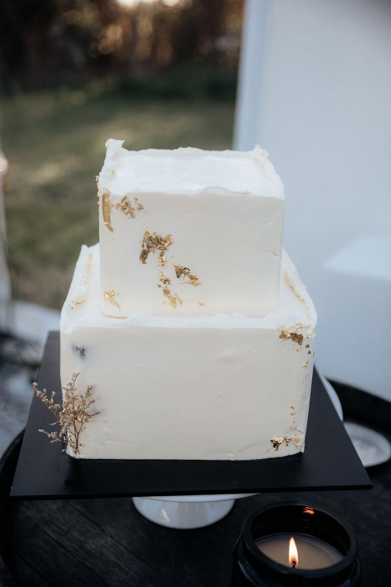 Real bride Hannahs white square wedding cake made by The Unbaked Bakery.